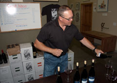 Owner/winemaker Rich Funk of Saviah Cellars pouring his Red Mountain Syrah