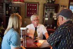 Kori and John visiting with owner Don Phelps at Hard Row to Hoe